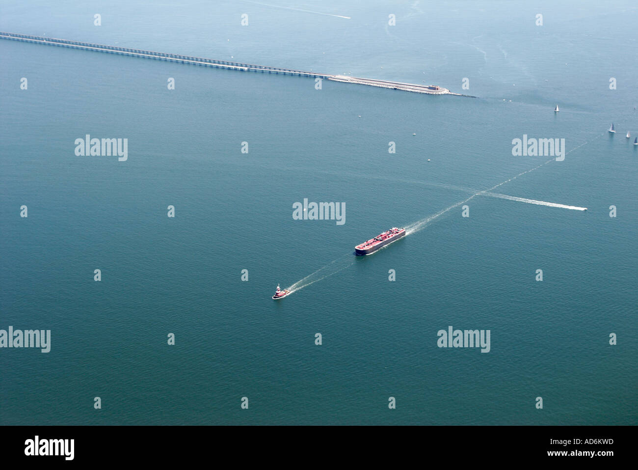 Chesapeake Virginia Bay Bridge Tunnel tugboat barge boats seen from commercial airlines landing at Norfolk - Stock Image