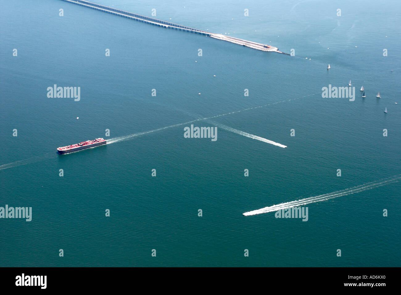 Chesapeake Virginia Bay Bridge Tunnel barge boats seen from commercial airlines landing at Norfolk - Stock Image