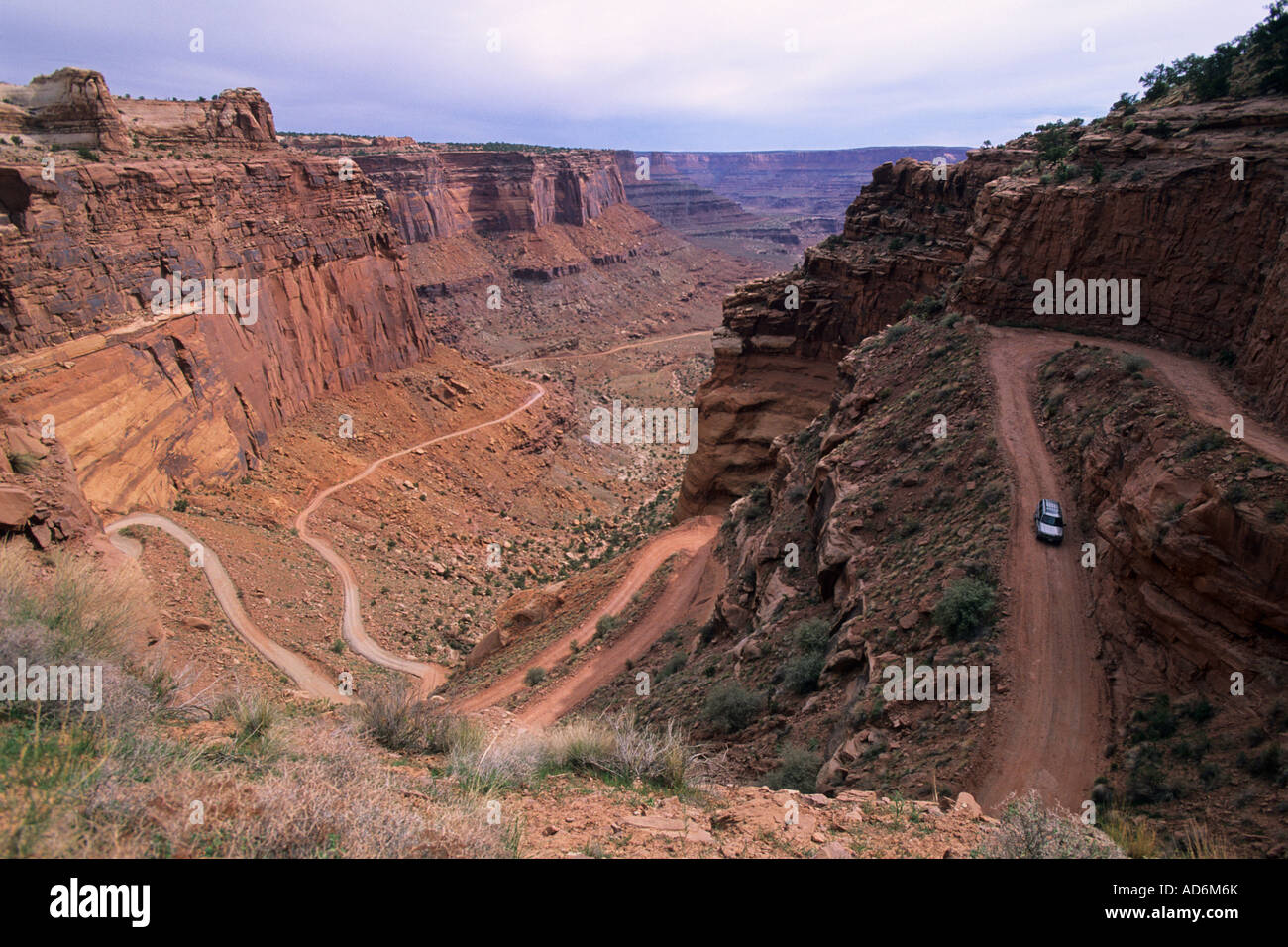 Driving on the Shafer Trail Road into Shafer Canyon Island in the Sky District Canyonlands National Park UTAH Stock Photo