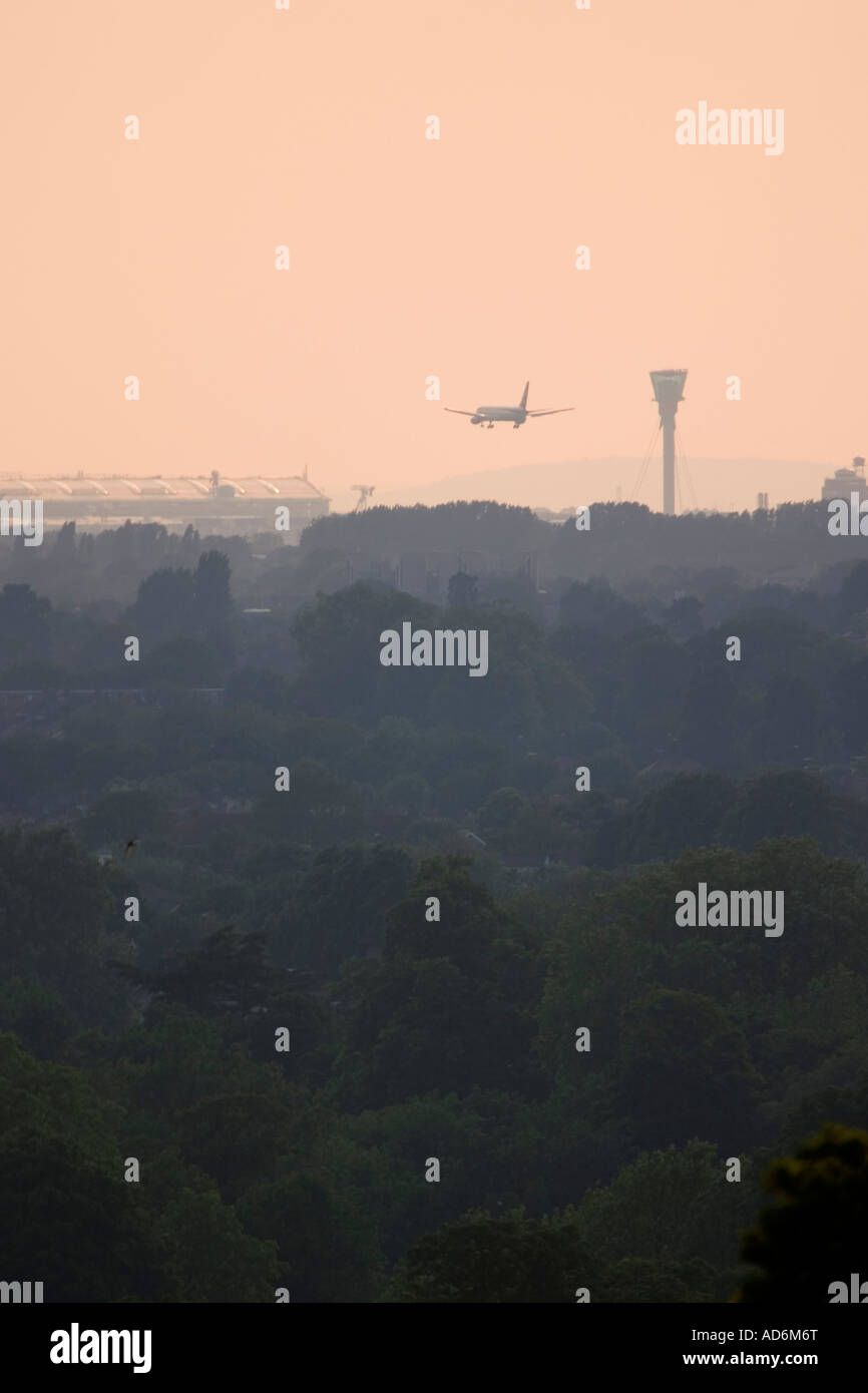 Commercial aeroplane coming to land at London Heathrow Airport view from Richmond Park Stock Photo