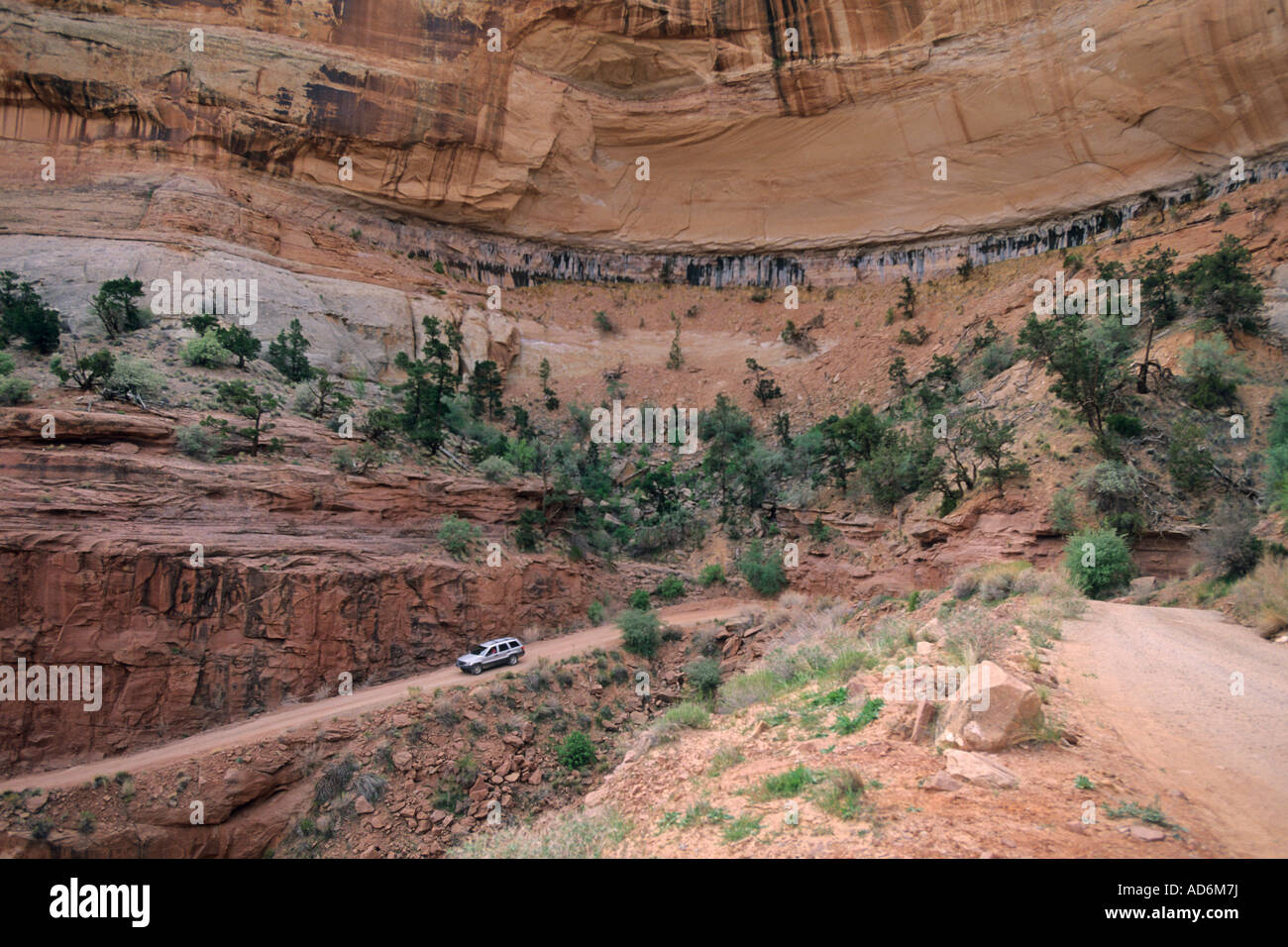 Driving on Shafer Trail Road into Shafer Canyon Island in the Sky District Canyonlands National Park UTAH Stock Photo