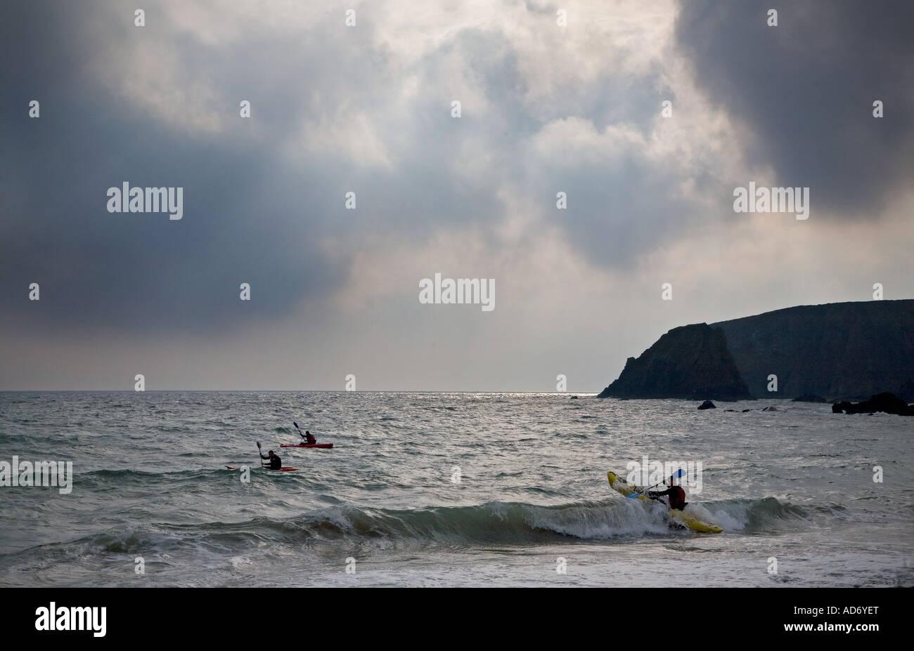 Kayaking at Kilfarassy Cove Copper Coast County Waterford Ireland - Stock Image