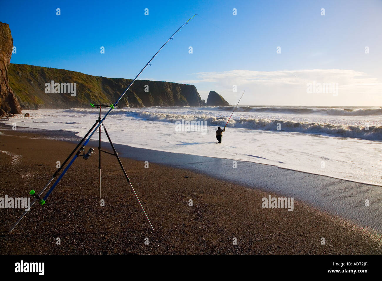 Sea Angling in Winter at Ballydowane Beach, Near Bunmahon, The Copper Coast, County Waterford, Ireland - Stock Image