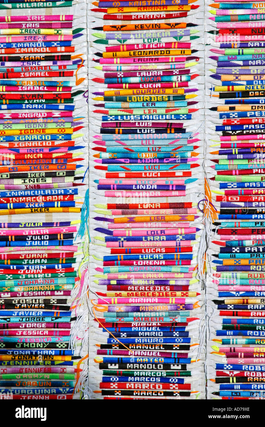 Colourful bracelets from cloth with names are being sold at a fleamarket in Spain, friendship bracelets