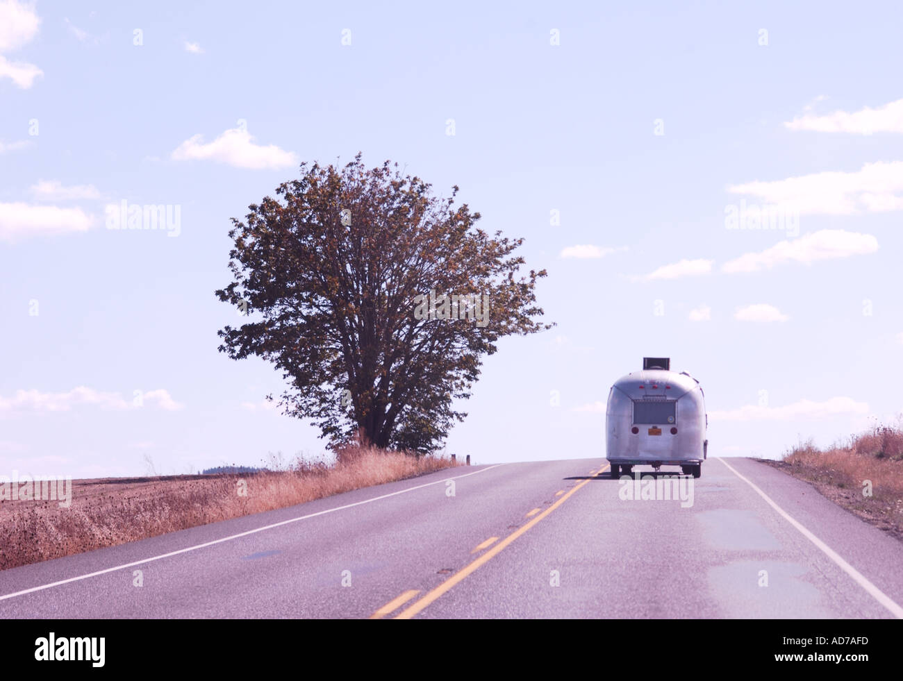 Airstream trailer on open country road - Stock Image