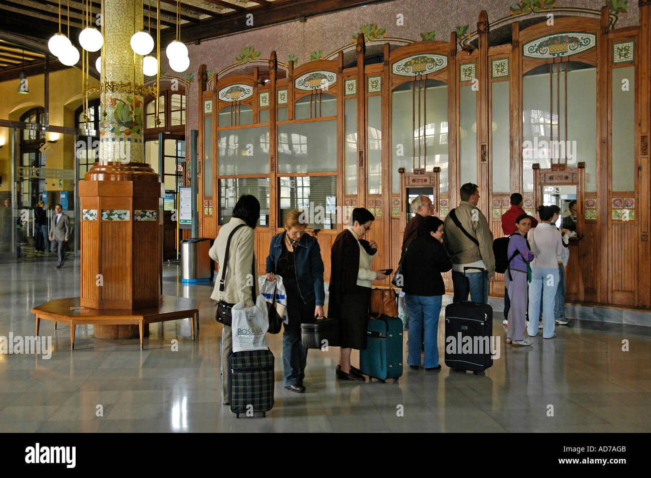 Travellers queueing in the lobby in front of ticket counters, main station, Valencia, Spain Stock Photo