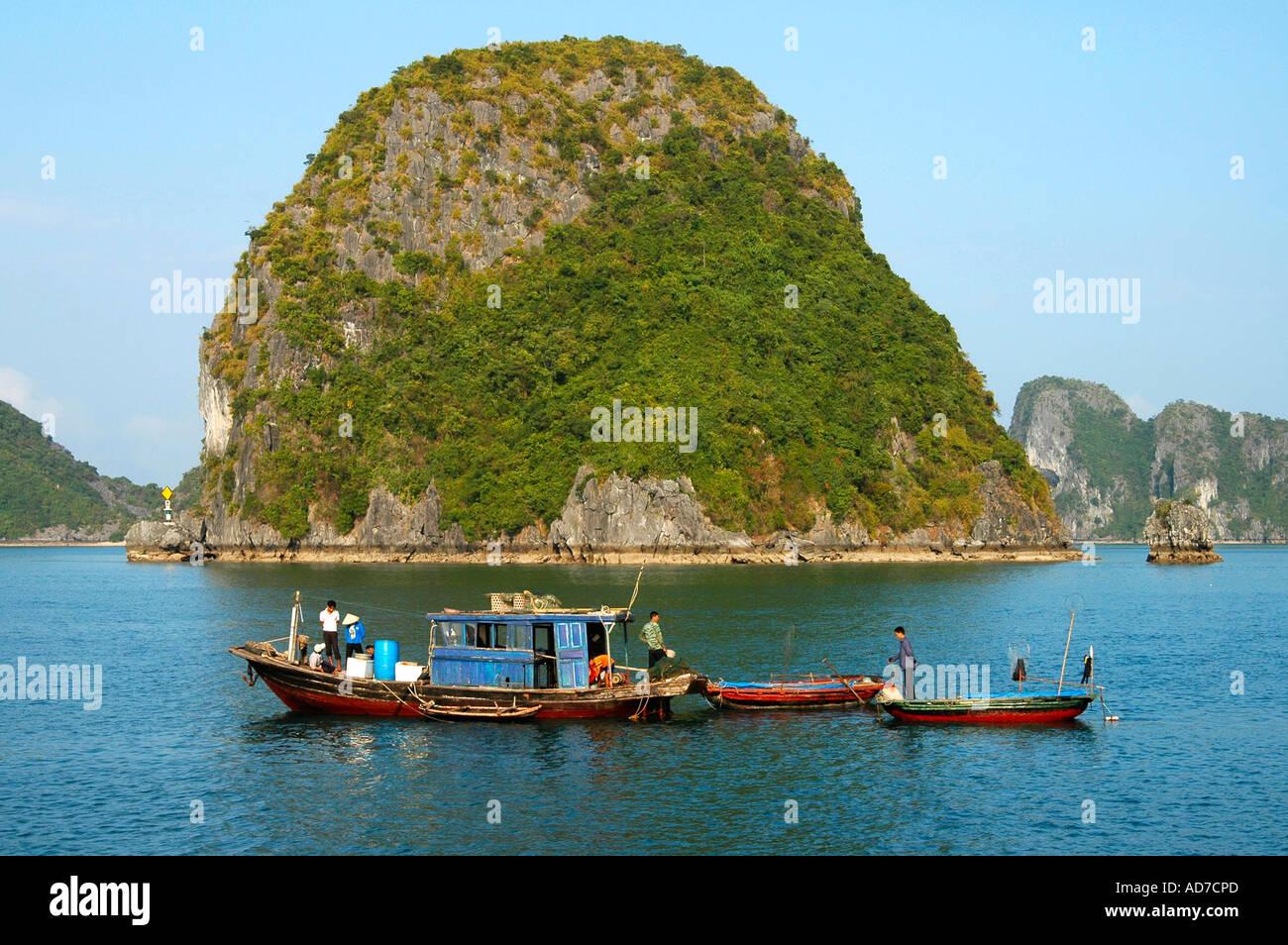 Fisher men fishing in Halong Bay Viet Nam - Stock Image