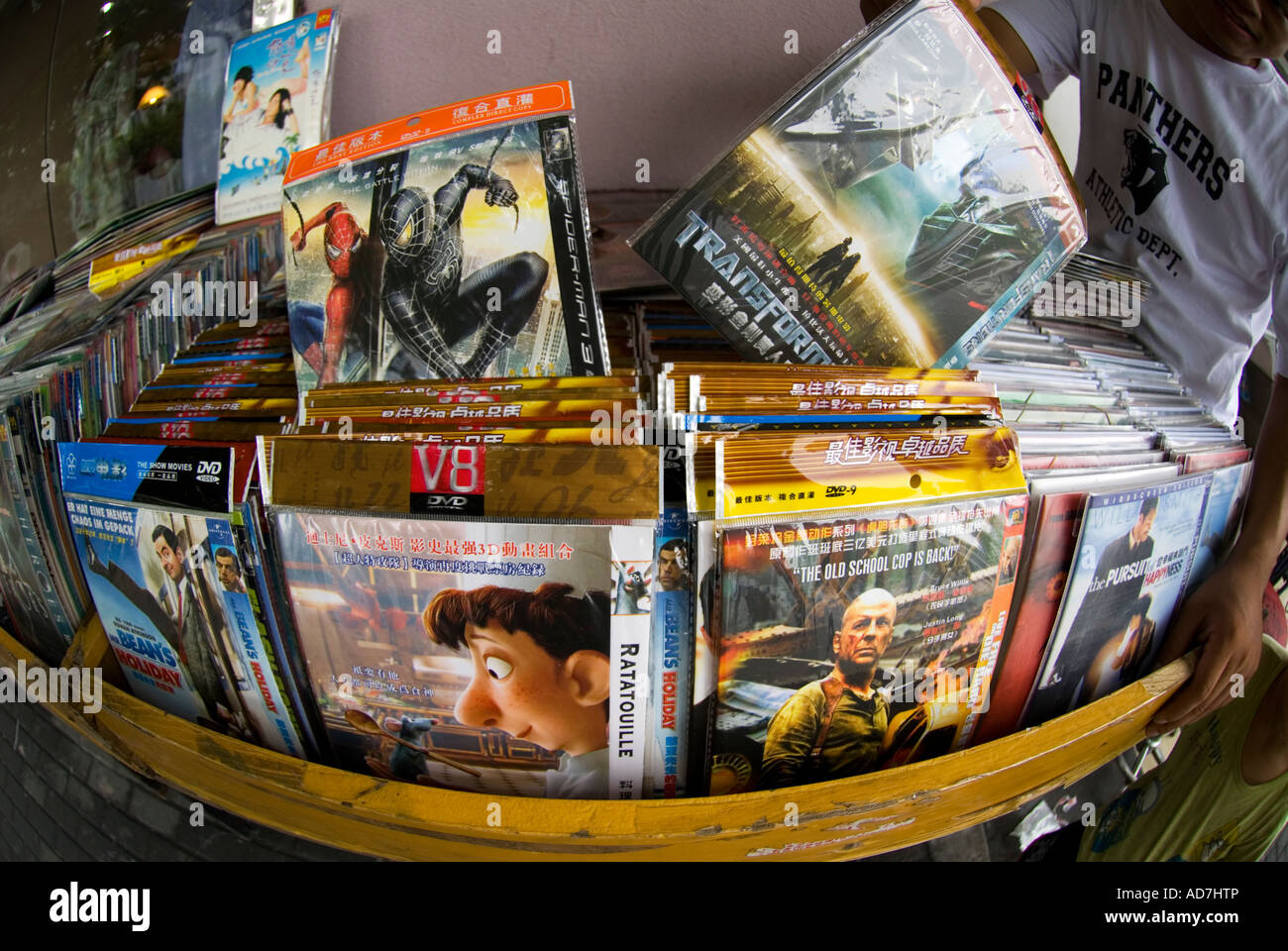 Counterfeit DVD movies for sale on a stall on Shanghai Street - Stock Image