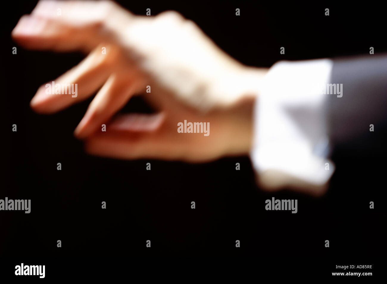 Orchestra conductors hand art orchestra performance performing art performing arts performance art classical music conductor - Stock Image