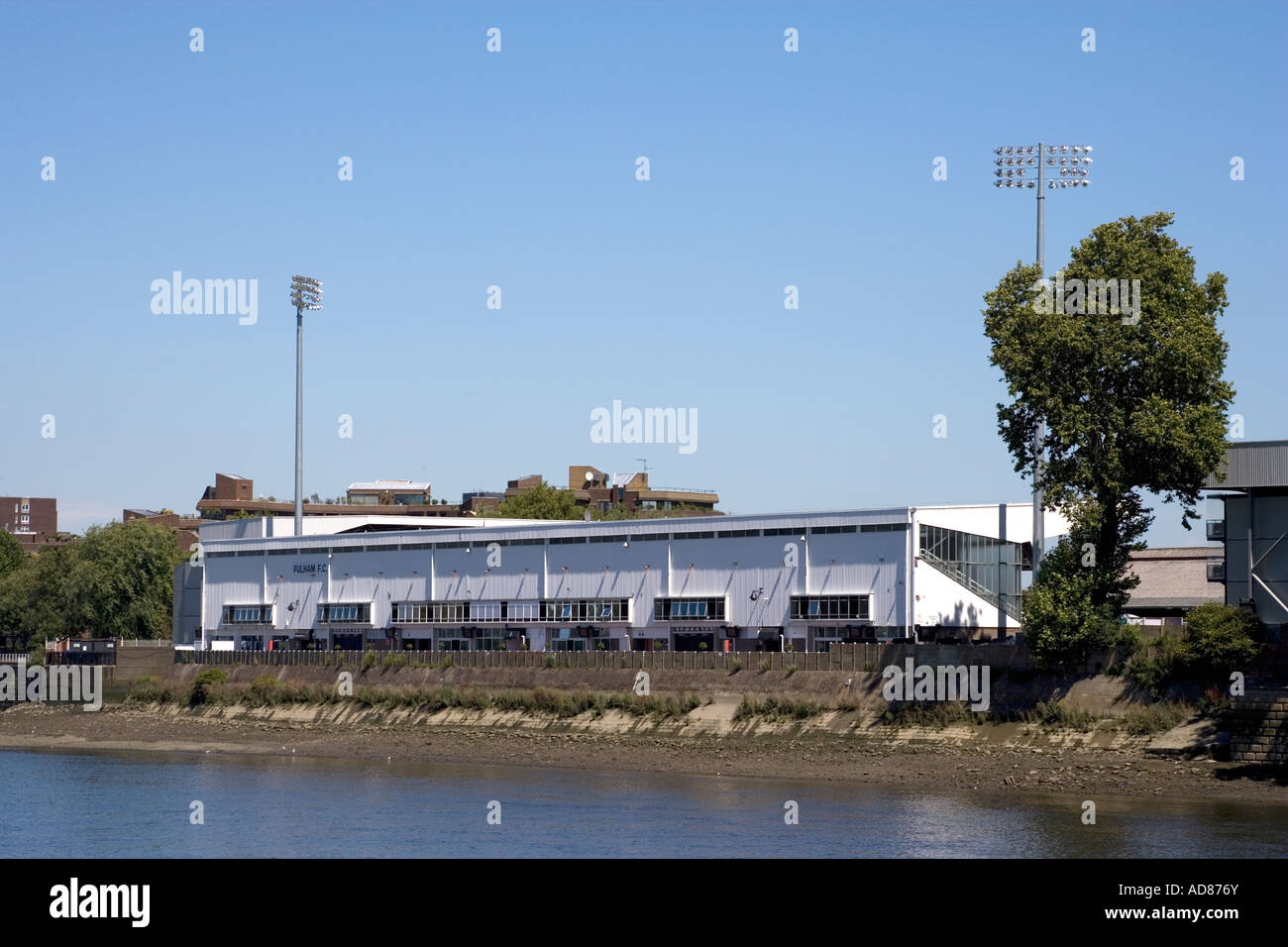 Craven Cottage Fulham FC from across River Thames London England - Stock Image