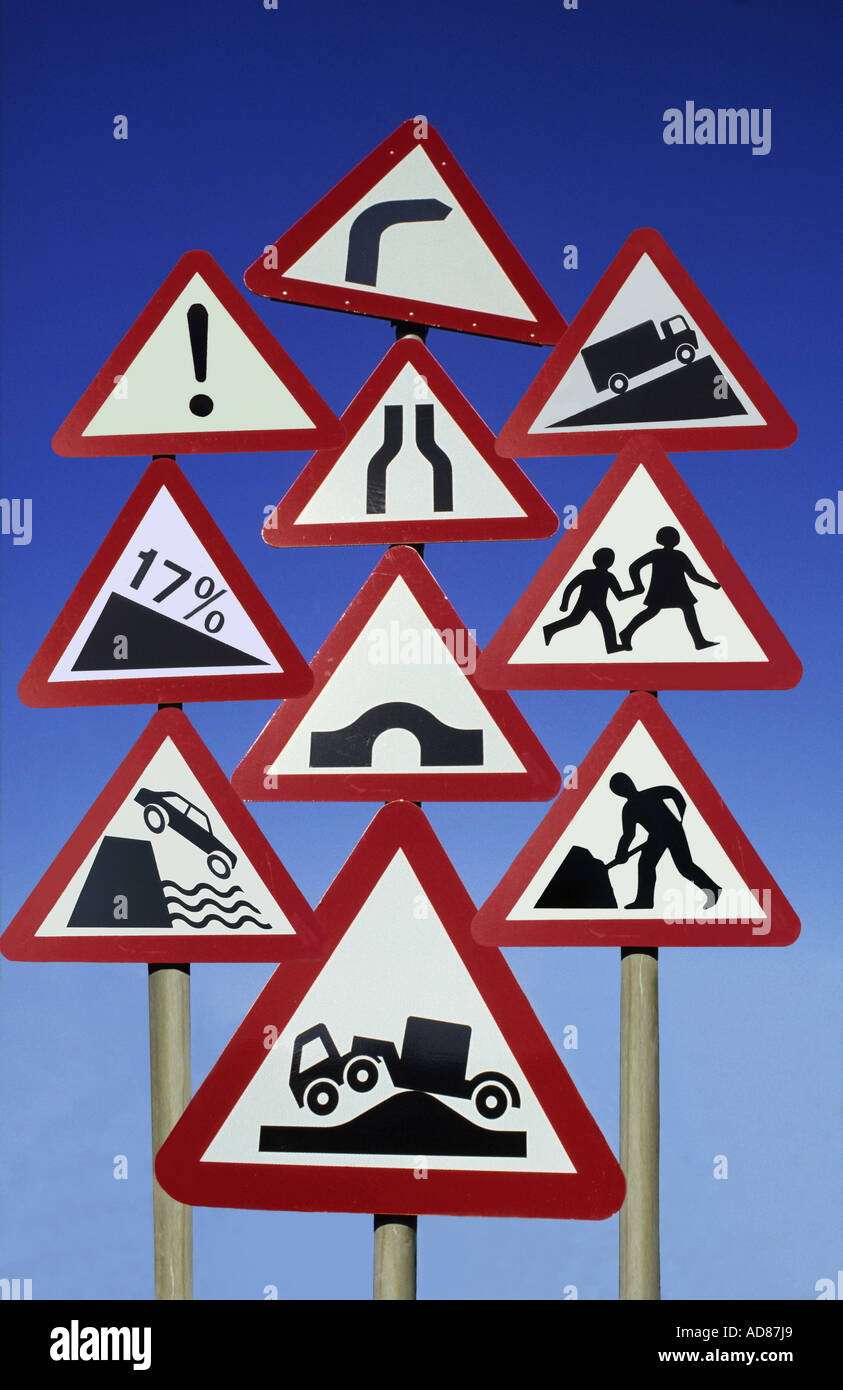 conceptual picture of rows of confusing road signs at the side of the road uk - Stock Image