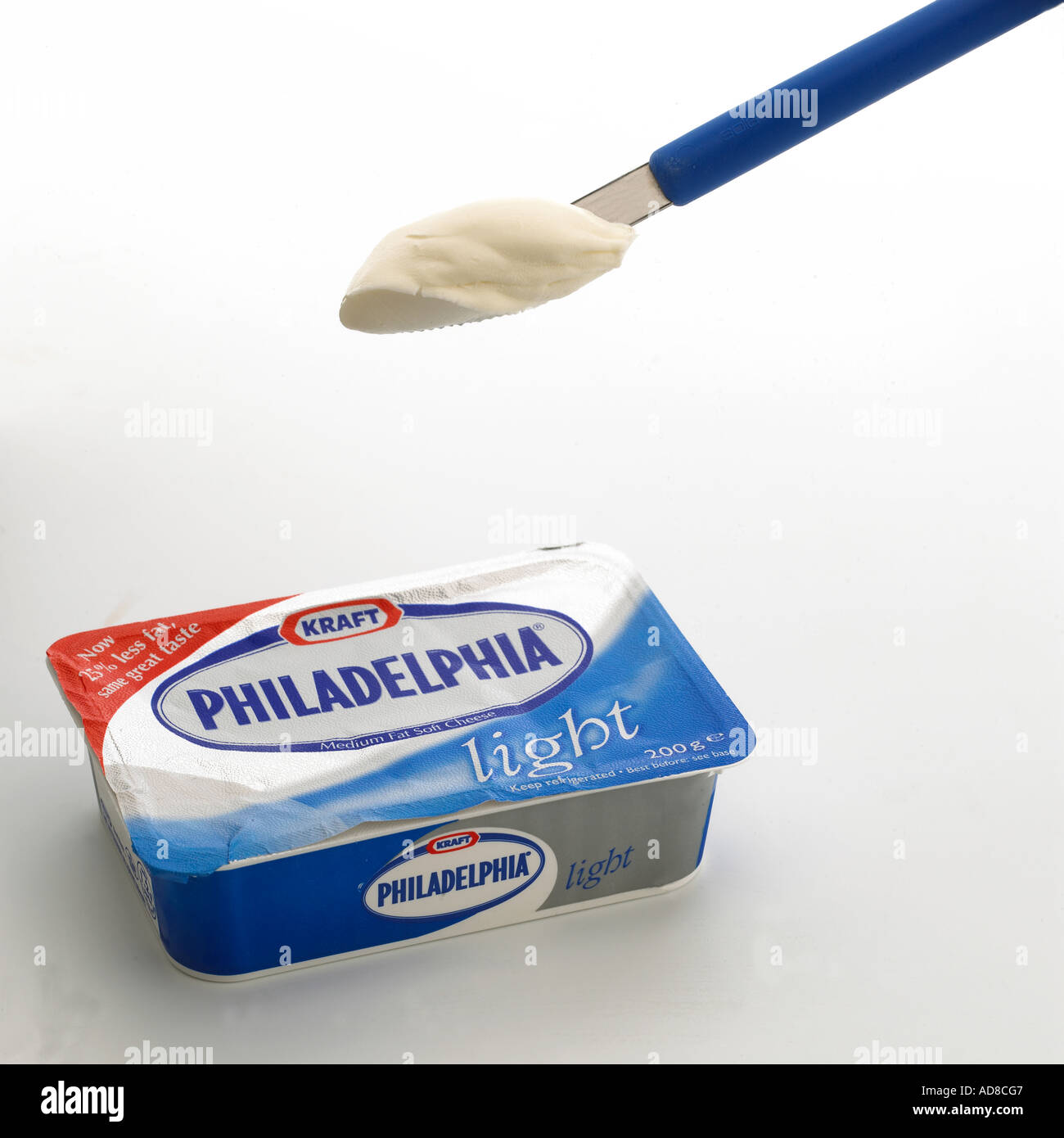 packet of philadelphia light cream cheese with small knife loaded