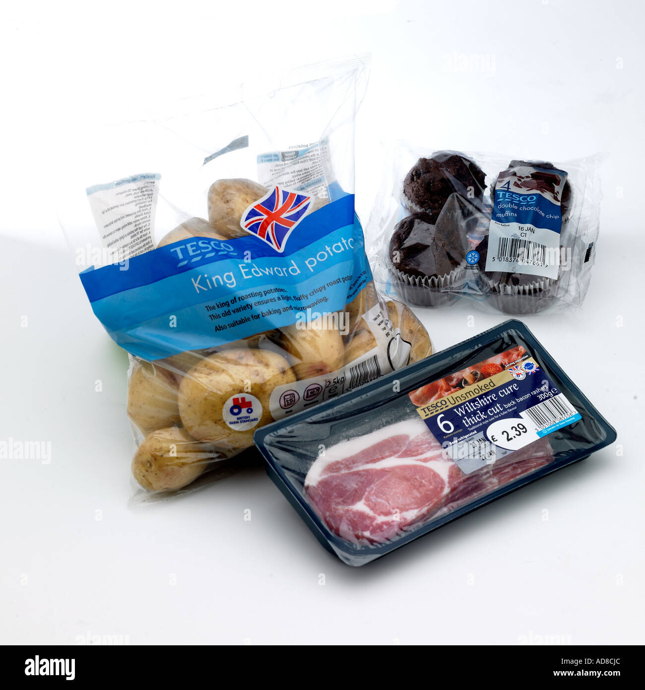 Selection of different types of food packaging cured bacon packet bag of King Edward potatoes chocolate muffins in plastic box - Stock Image
