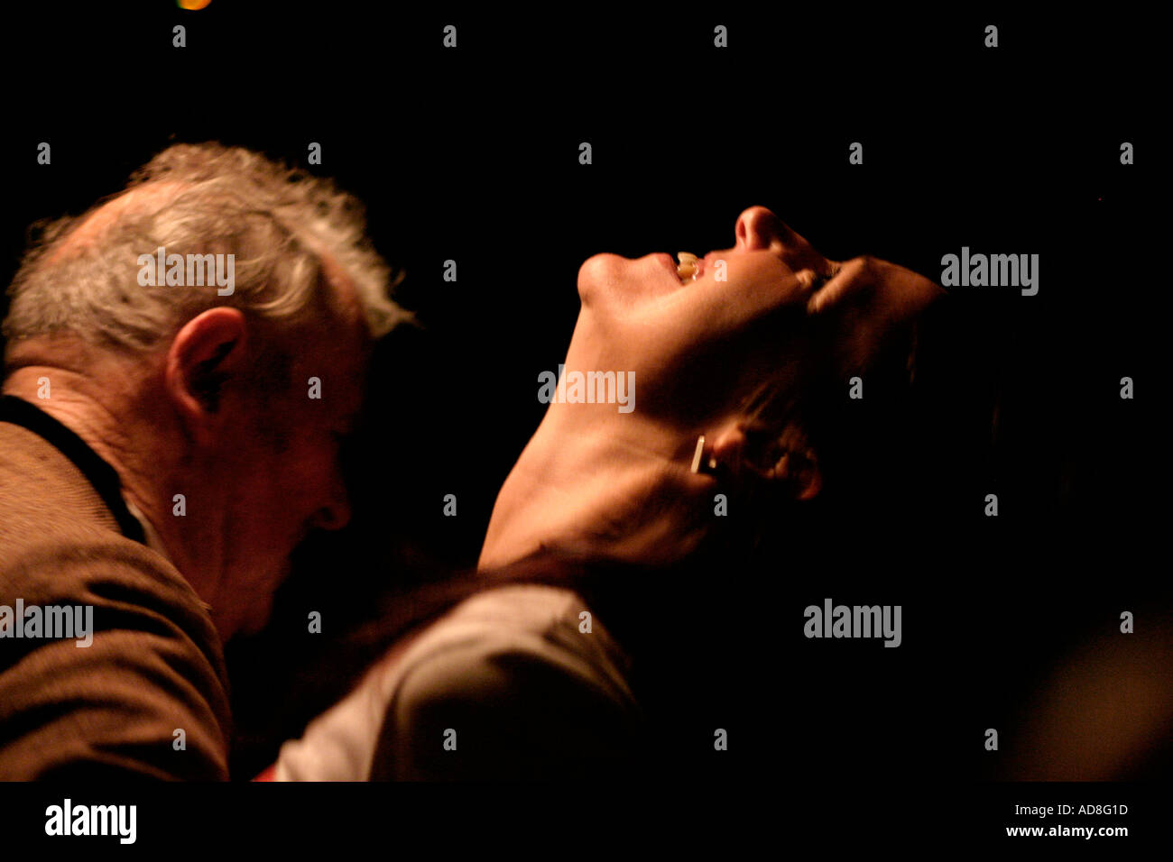 A climatic moment in an impromptu celtic dance An old man dancing with a younger woman - Stock Image