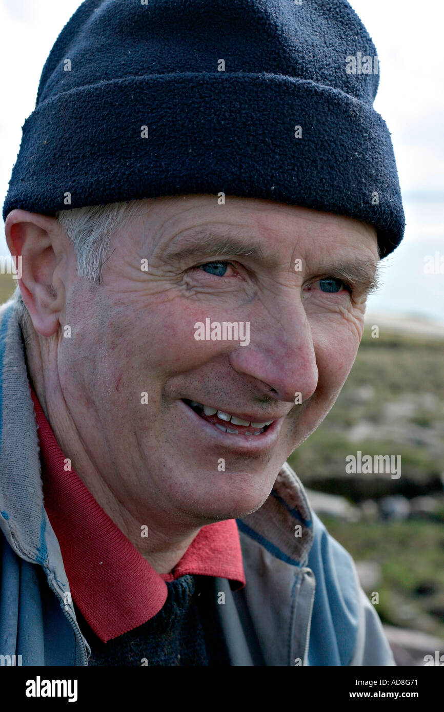 Traditional peat digger Chris Gallagher takes a break from the back breaking work Achill Island County Mayo Ireland - Stock Image