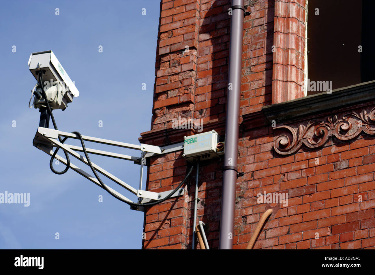 Big Brother style surveillance camera on a historic building in the UK - Stock Image