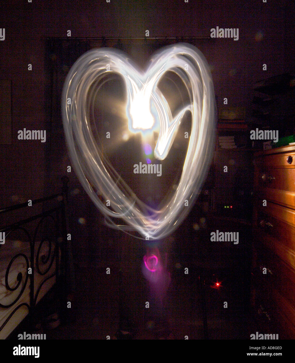 Painting with light heart shape - Stock Image