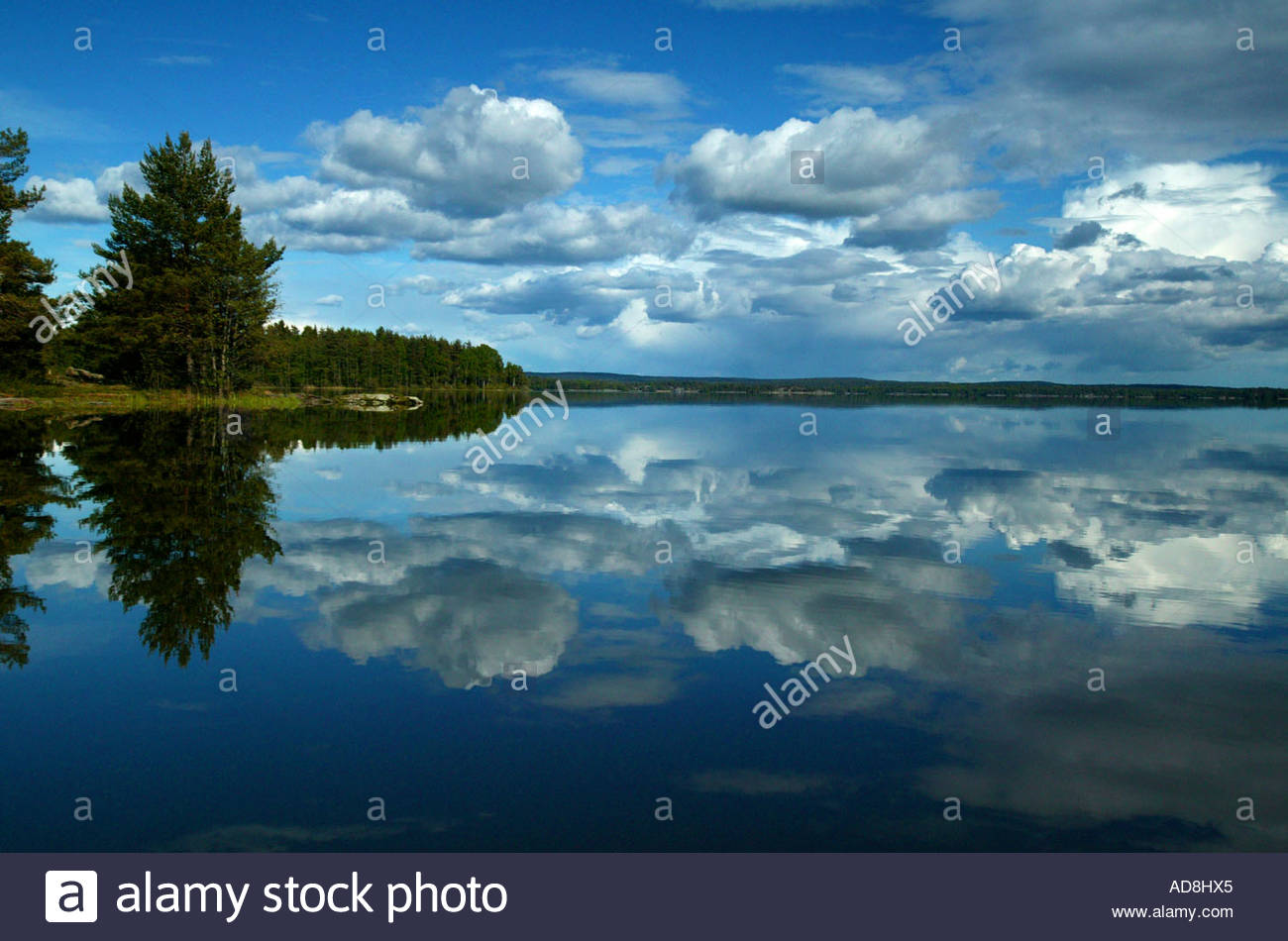 Clouds reflected on a blank water surface in the lake Vansjø, Østfold, Norway. - Stock Image