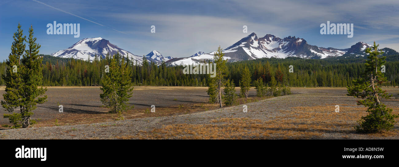 Panorama of Three Sisters and Broken Top mountains from Dutchman Flat Deschutes National Forest Bend Oregon USA - Stock Image