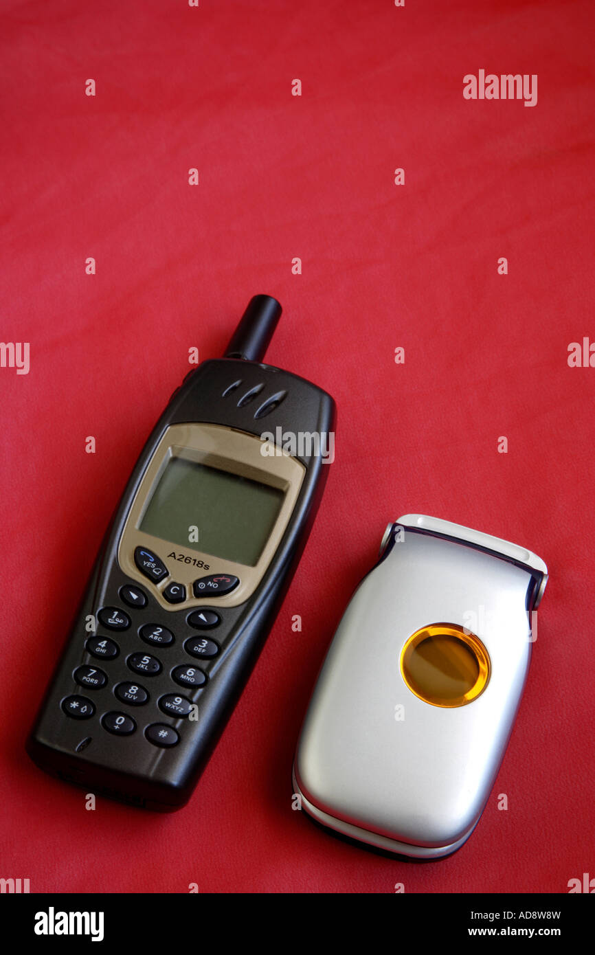 Two Mobile Phones Old mid 199O' s and New Style - Stock Image