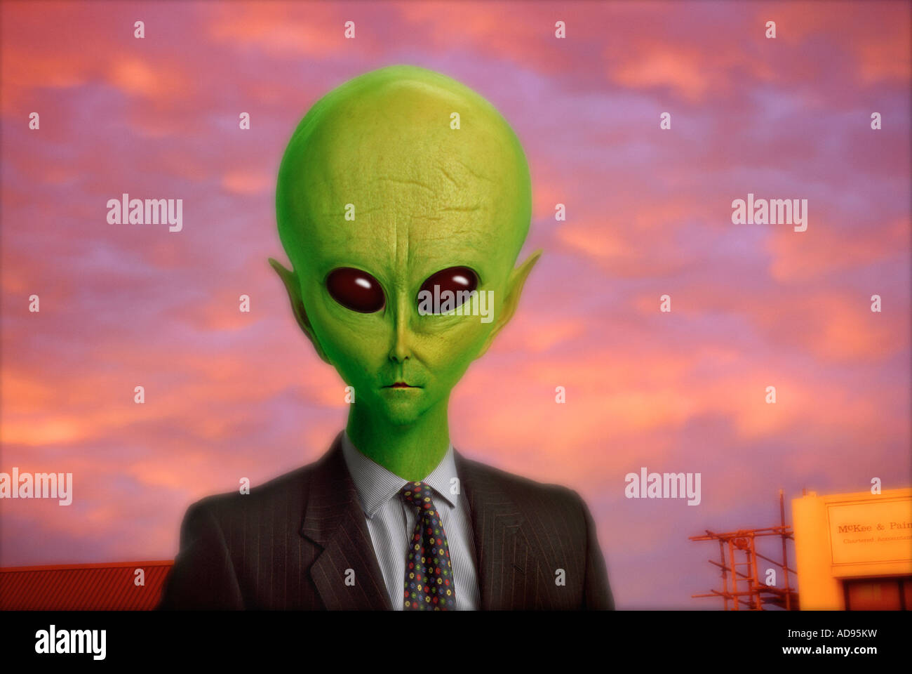 Photo illustration of alien dressed as businessman - Stock Image