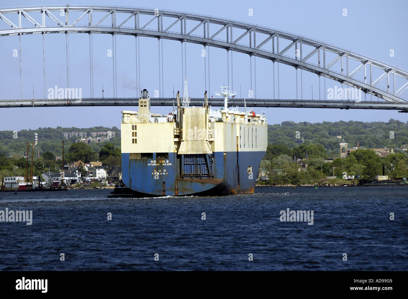 The Hyundai 205, an automobile transport ship of the Eukor lines prepares to bpass under the Bayonne Bridge. - Stock Image