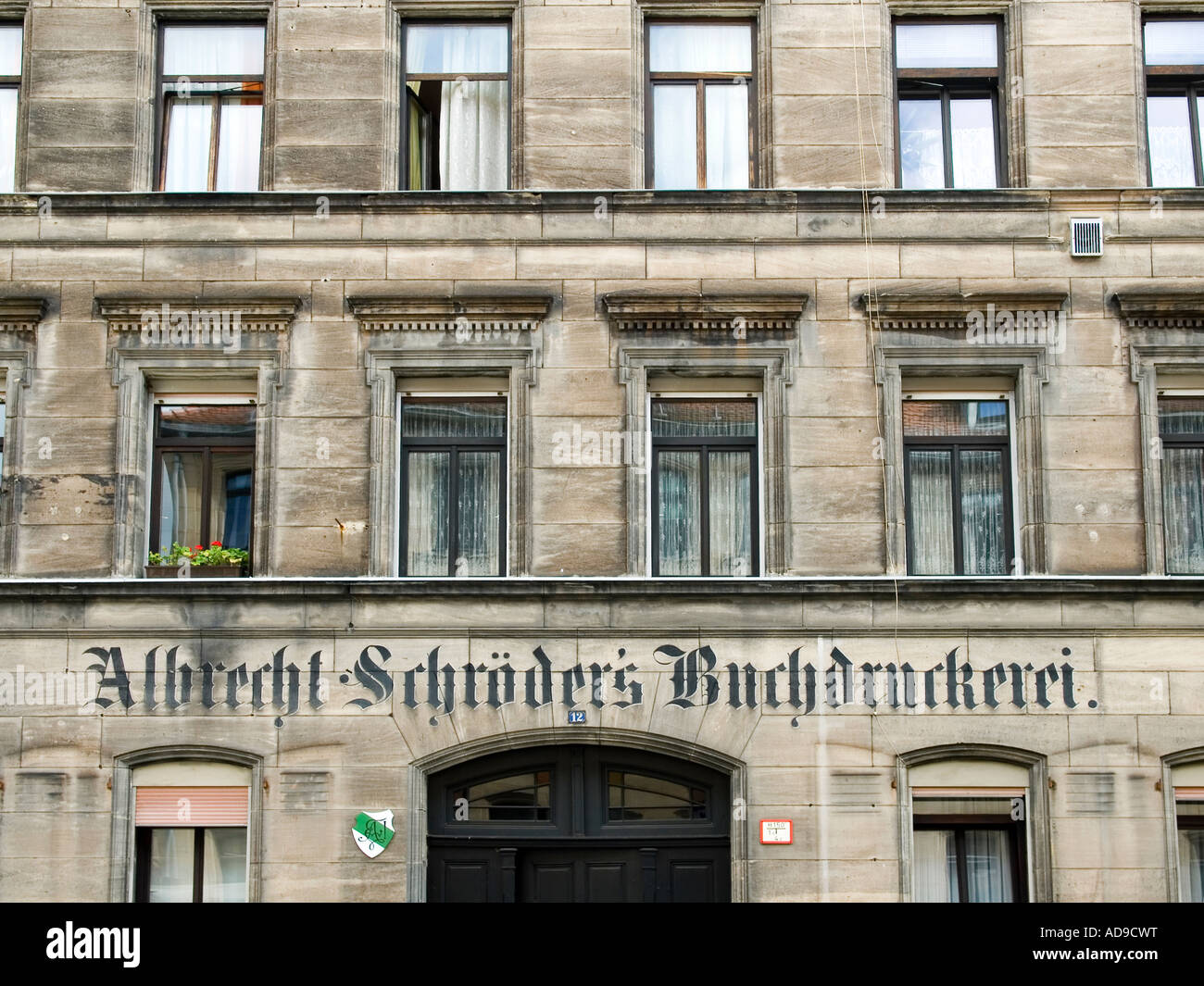 facade in classicism style with old inscription for a book printery in old town of Fuerth Bavaria Germany - Stock Image