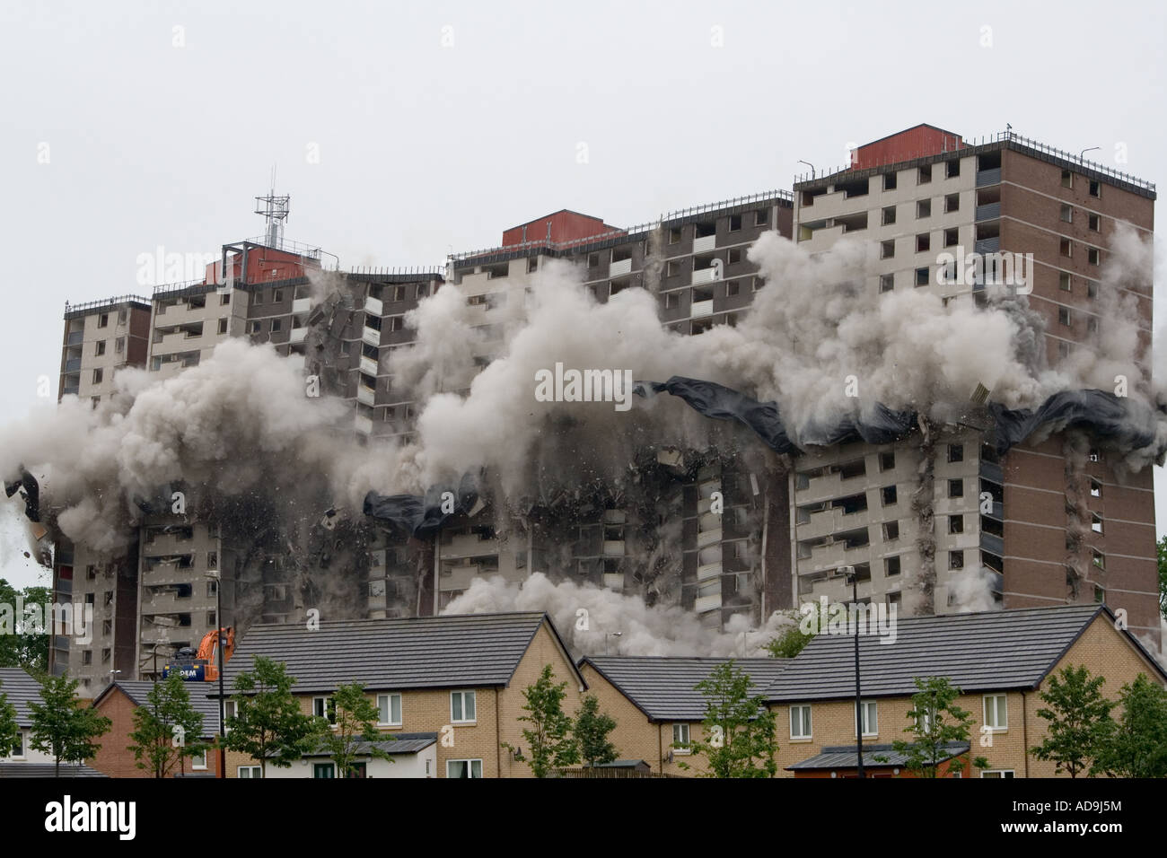 Clouds of dust engulf Ardler village after controlled explosions demolishing the last multi-storey building in Dundee, Stock Photo