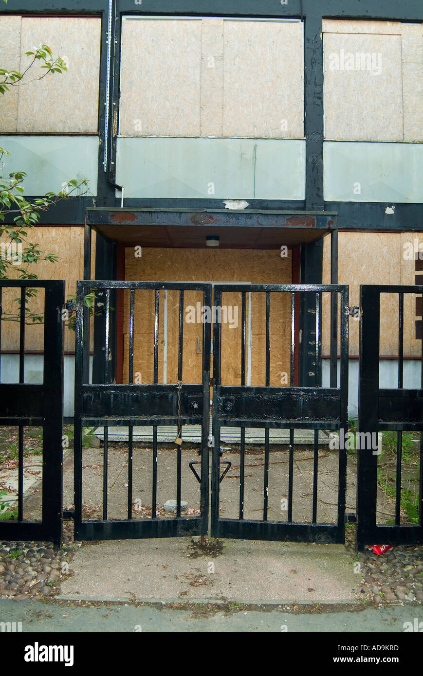 Abandoned offices in Widnes, Cheshire,  remain empty and secured to minimise vandalism - Stock Image