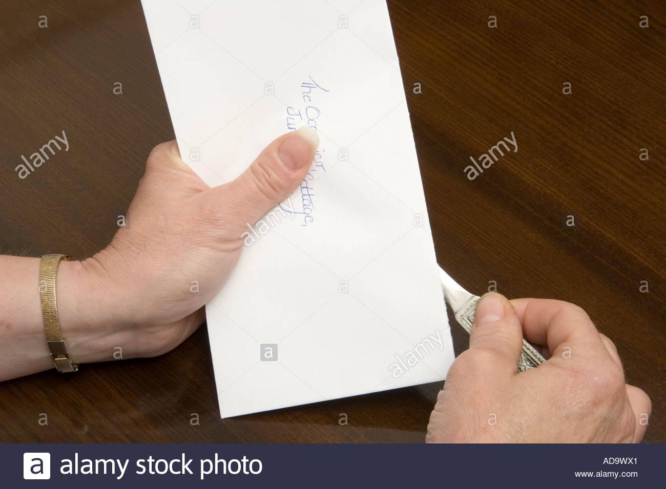 ^Opening an envelope, UK. - Stock Image