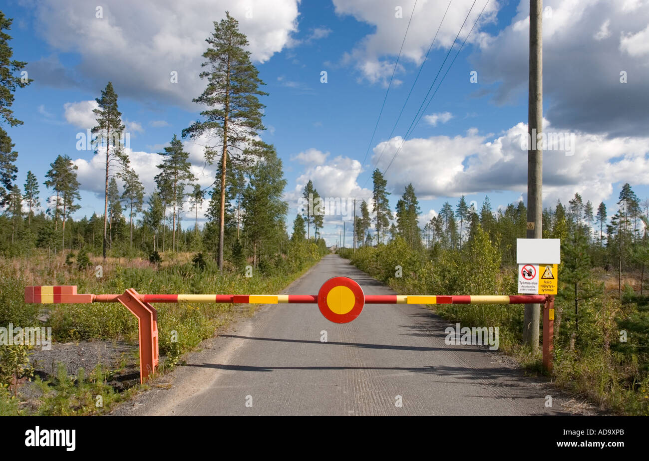 Boom closing a road and a Finnish traffic sign 311. ( Closed to all vehicles ) , Finland - Stock Image