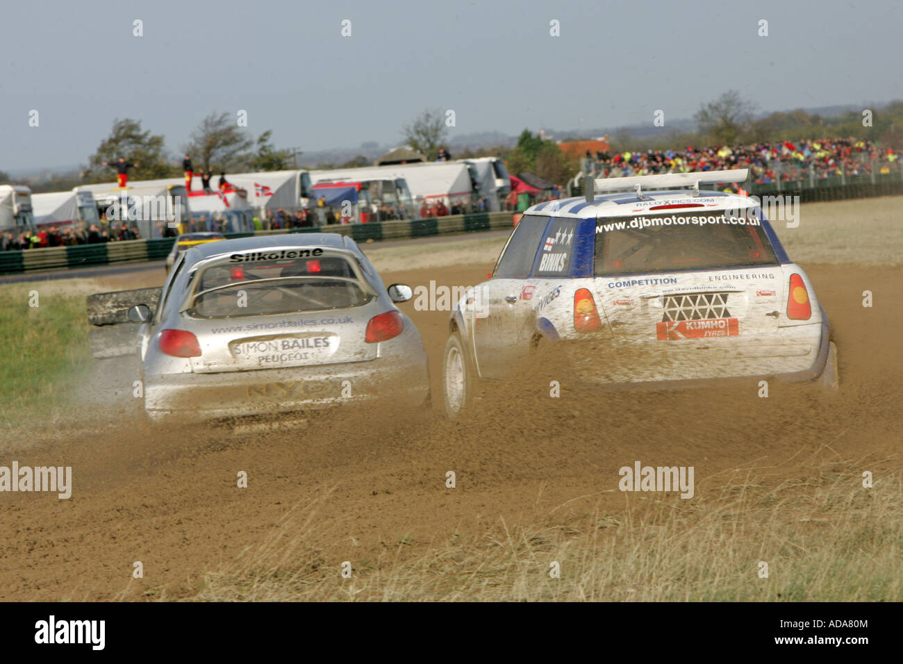 A Mini and peugeot 206 fight it out during a Croft Rallycross meeting Stock Photo
