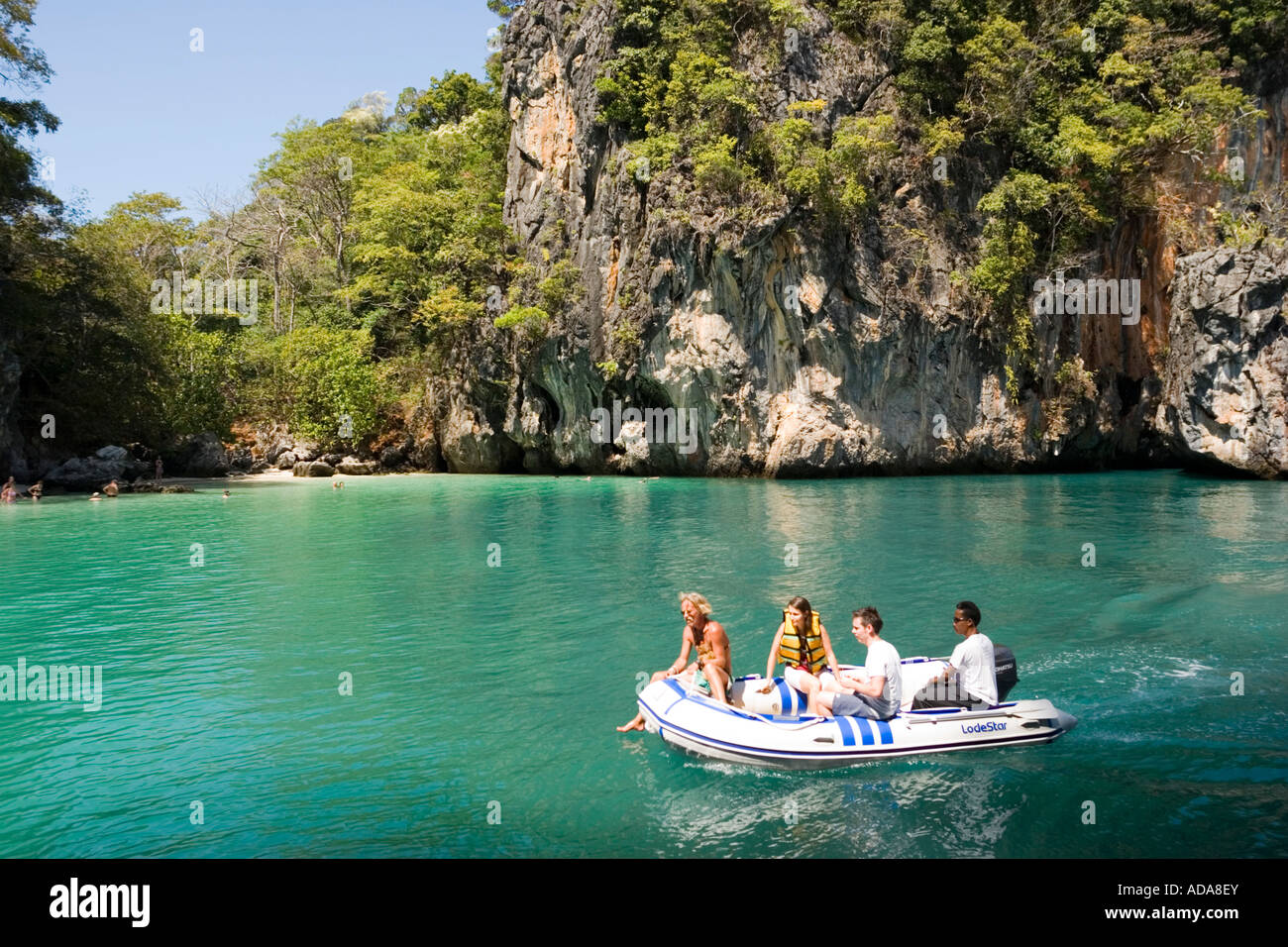 Tourists Having A Boat Trip Along Lading Island Krabi
