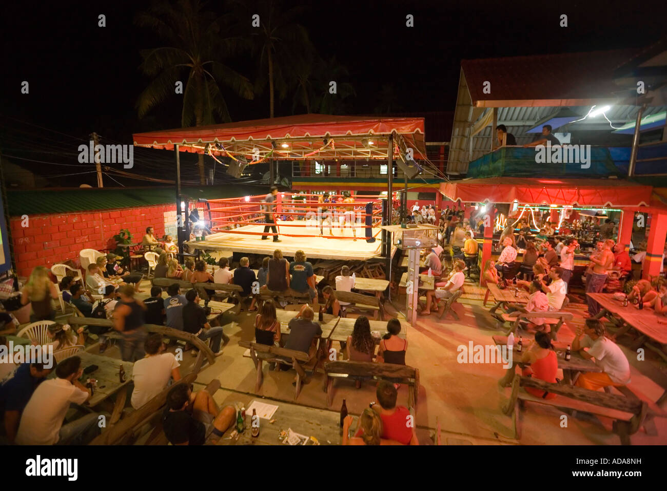 Tourists watching Thai Boxing in the open air area of the