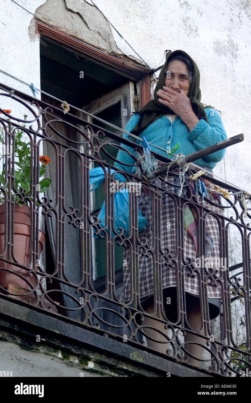 Local Portuguese woman on her balcony in a small town in northern central portugal - Stock Image