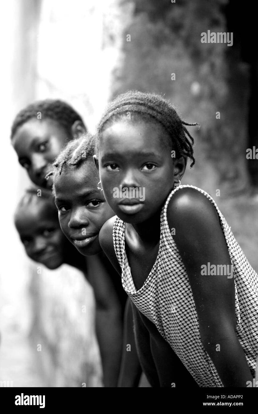 Vertical black and white portrait of group of children in street in sierra leone west africa