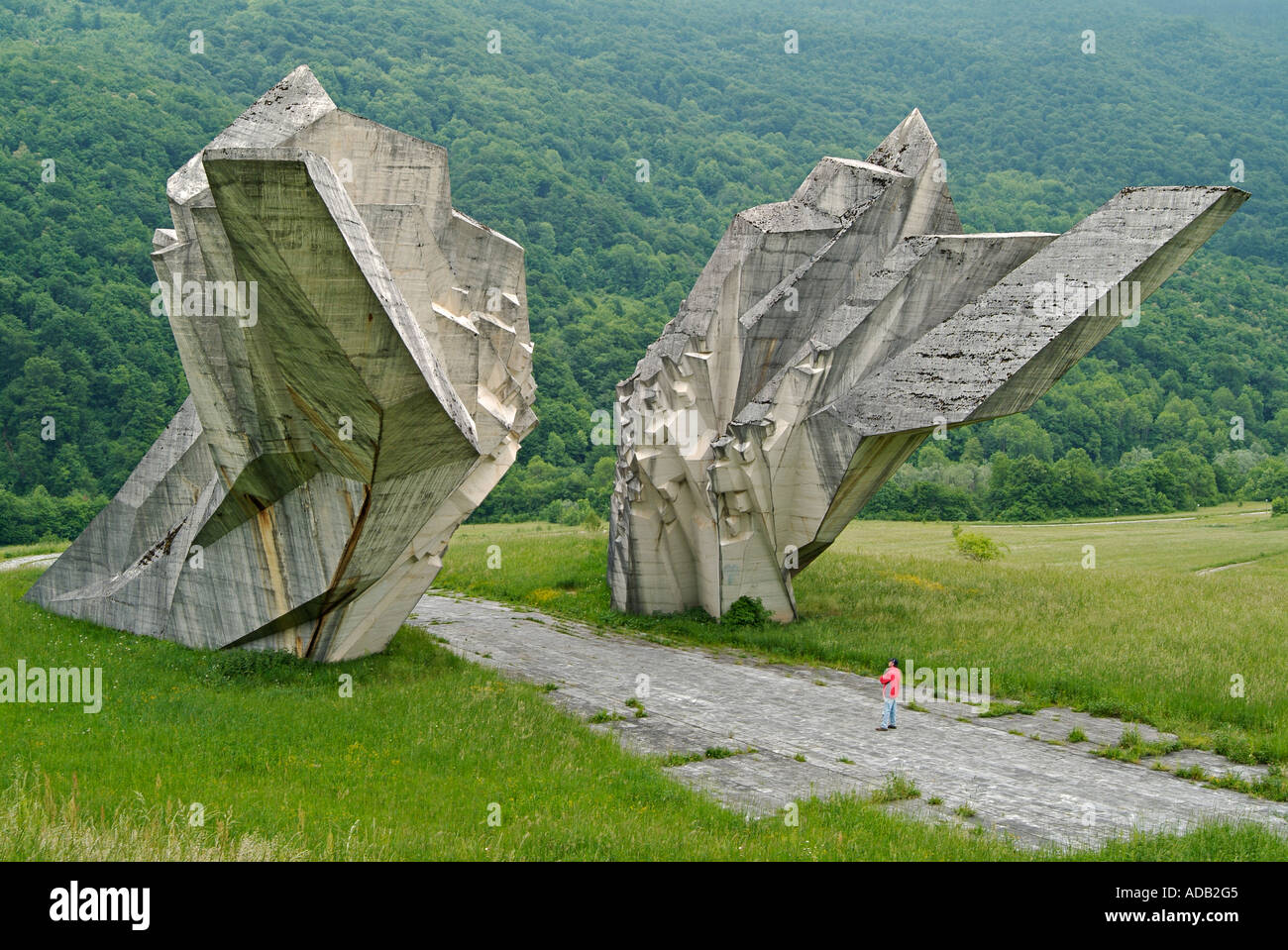 Lone Man Looking at the Sutjeska Monument Built to Commemorate the 3301 Partisan Fighters Killed by Nazi Germans and Croatians - Stock Image