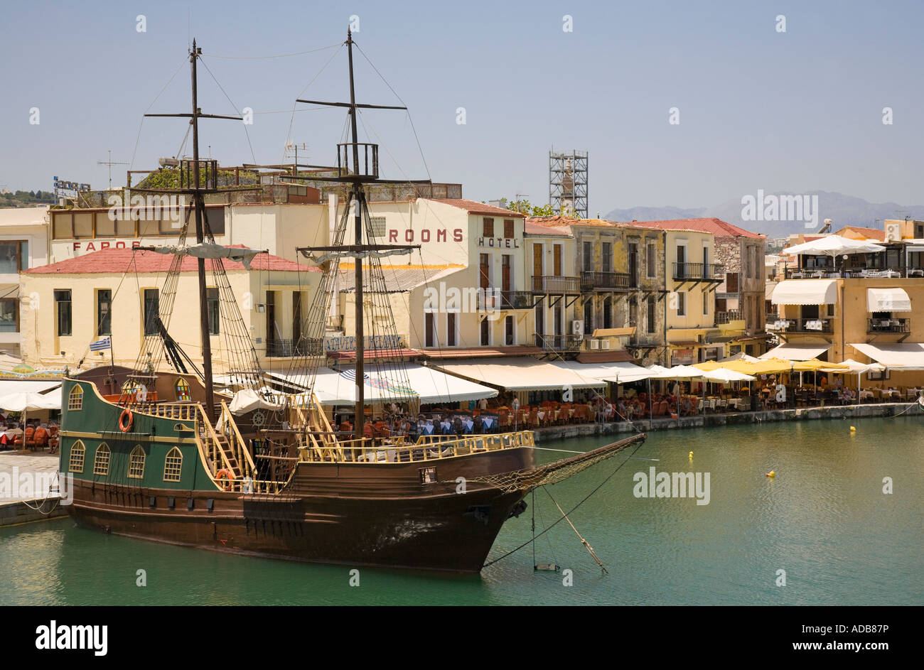 The tourist ship 'Captain Hook', styled as a pirate ship, in the Venetian harbour of Rethymnon / Crete / - Stock Image