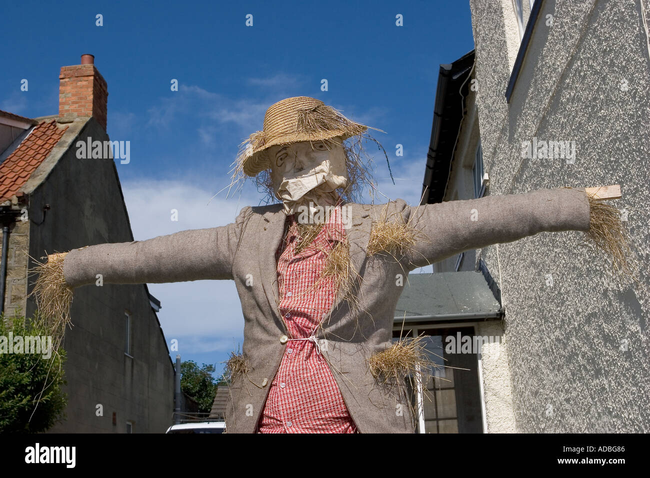 Straw Scarecrow at the Scarecrow Festival, Hinderwell, Yorkshire Valley, North Yorkshire, Northern England, UK Stock Photo