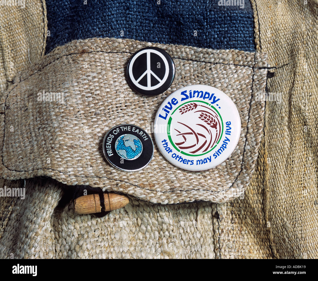'Live Simply.. that others may simply live' and other badges, on a shoulder bag made from hemp. - Stock Image