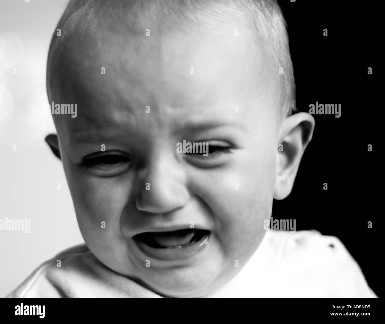Baby boy crying in mono - Stock Image