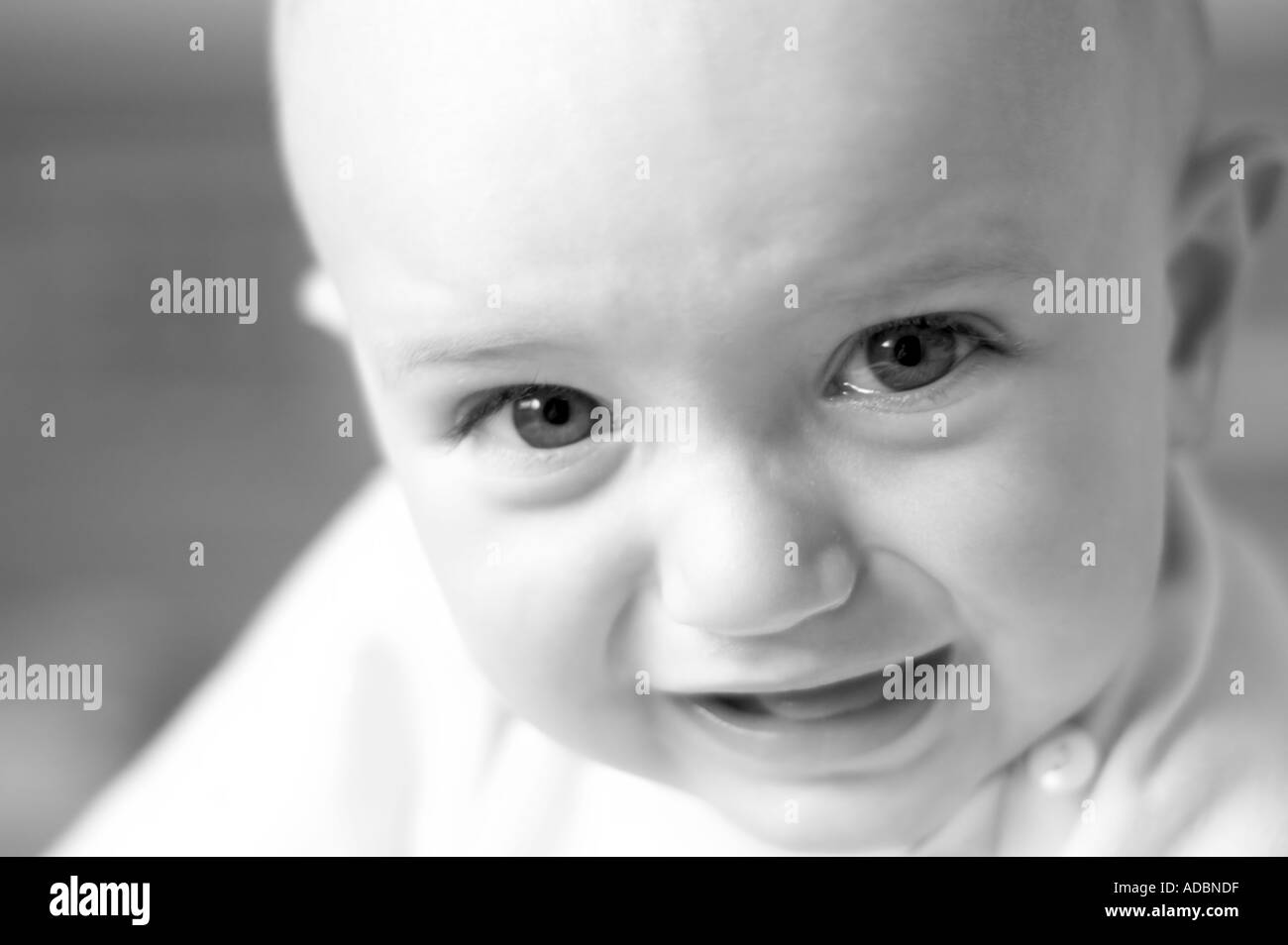 Nine month old baby boy crying - Stock Image