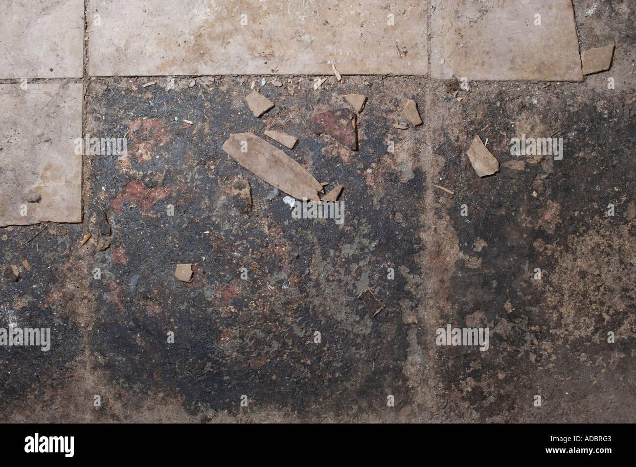 Asbestos Tile In Basement Floor Crumbling Stock Photo