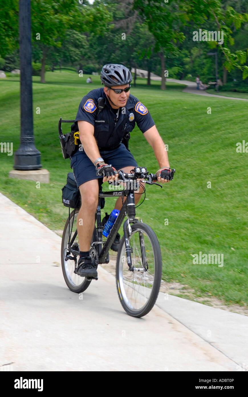 Grand Rapids Michigan Policeman patrol downtown streets on bicycles - Stock Image