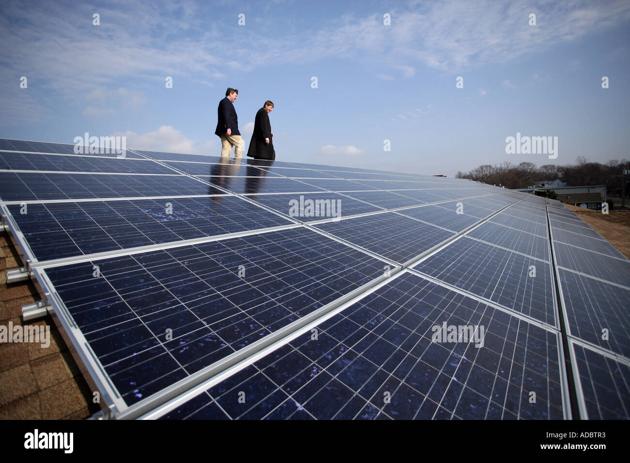 Solar Panels on a business building  in Connecticut allows the owners to sell electric power back to the power company - Stock Image