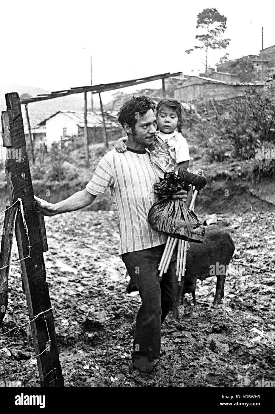 Tegucigalpa, Honduras. A poorman with his dauhter. Stock Photo