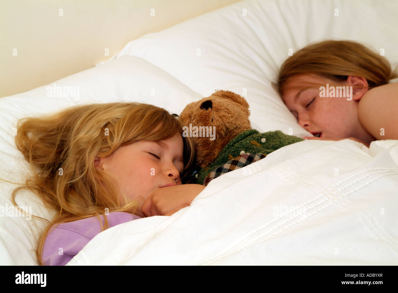 Children Sleeping On Pillow In Bed Little Girls Fast