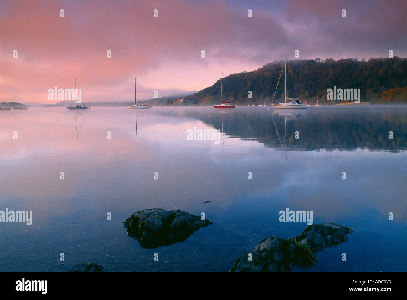 boats on Lake Windermere at dawn Lake District Cumbria England UK - Stock Image