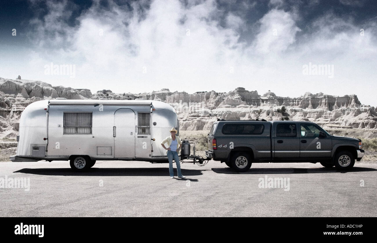 postcard like image of vintage airstream, Bad Lands South Dakota with stormy sky air stream - Stock Image