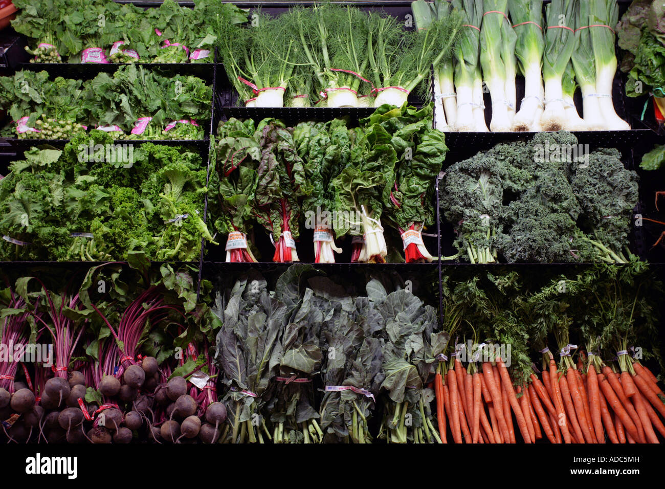 Organic Foods in a supermarket display case. Healthy eating health foods. Greens Stock Photo
